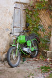 Balkan feeling. Unk green motorbicycle in autumnal circumstances from the Balkan Stock Images