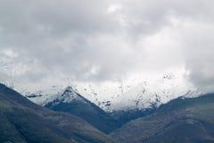 Balkan Mountains snowcapped peaks. Snowed peaks covered in clouds royalty free stock image