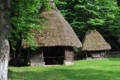 Balkan style ancient house building in forest royalty free stock photos