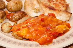 Balkan tomato stew with fried chicken and pork meat Stock Photography