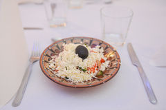 Balkanian food in restaurant. Balkanian, bulgarian cheese salad on restaurant table Stock Images