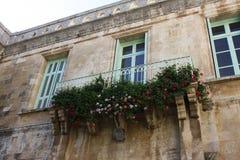 Balkong av blommor royaltyfria foton