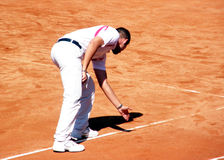 The ball is in!. The referee decides that the ball is in during the tennis match between Albert Montanes vs. Yuri Schukin. Genoa Open Challenger Royalty Free Stock Image