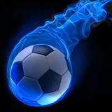 Ball. Magic soccer ball in the blue flame Stock Photo