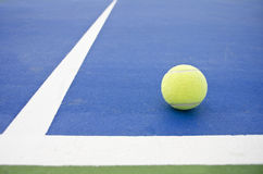 Ball in!. A image of a ball on concrete court Royalty Free Stock Photos