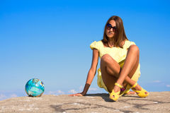 Ball. Swarthy young girl poses on the beach Royalty Free Stock Photo