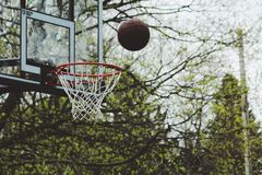 Ball above basket Royalty Free Stock Photography