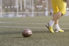 Ball and American football player on the field stock image