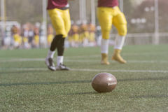 Ball and American football players on the field royalty free stock photo