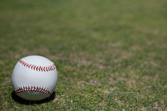 Ball on baseball field Royalty Free Stock Photo