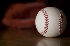 Ball and baseball glove. Ball and glove, baseball goods Royalty Free Stock Photo