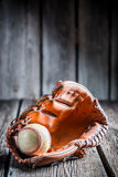 Ball of baseball and leather glove Stock Image