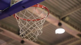 Ball in the Basket. Successful throw in basketball basket stock footage