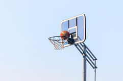 Ball into the basketball hoop Stock Photos