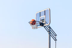 Ball into the basketball hoop Royalty Free Stock Photography