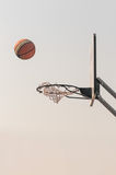 Ball into the basketball net Stock Images