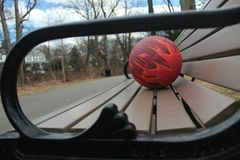 Ball for basketball on a park bench royalty free stock photography