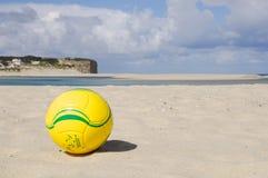Ball on the beach. Yellow ball on the beach Royalty Free Stock Photos