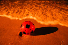 Ball on the beach Stock Image