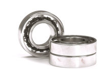 Ball bearing behind a stack of two ball bearings Royalty Free Stock Photography