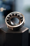 Ball bearing. With bokeh background Stock Photography