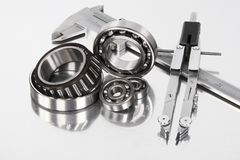 Ball bearing on metal background. Ball bearing with tool on metal background Royalty Free Stock Photos