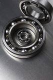 Ball-bearing study. Ball-bearings against brushed aluminum Stock Photo