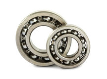 Ball bearings. Two ball bearings on white background royalty free stock photography