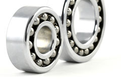 Ball bearings. Two ball bearings on white background royalty free stock images