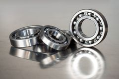 Ball-bearings. On a polished steel surface stock image