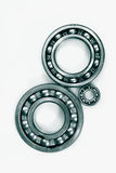 Ball bearings against light background. Ball-bearings against a light background, metal blue-green toning concept royalty free stock photos