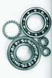 Ball bearings against light background. Ball-bearings against a light background, metal blue-green toning concept royalty free stock images