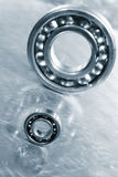 Ball-bearings against titanium Royalty Free Stock Image
