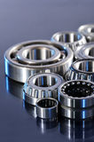 Ball-bearings. Closeup view of several ball-bearings in blue light stock images