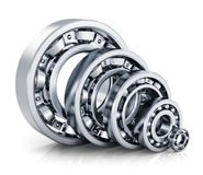Ball bearings. Collection of different steel shiny ball bearings isolated on white background with reflection effect Stock Photos