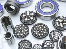 Ball bearings and components. Industrial ball bearings on display with cross sections , metallic balls, cylinders and sealing gaskets royalty free stock image