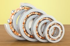 Ball bearings, cutaway on the wooden table. 3D rendering. Ball bearings, cutaway on the wooden table. 3D Royalty Free Stock Photography