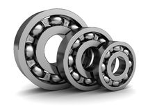 Ball bearings. 3d illustration of three ball bearings over white background Royalty Free Stock Photos