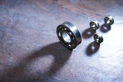 Ball Bearings On Dark. Set of ball bearings on dark background with long shadow royalty free stock photography
