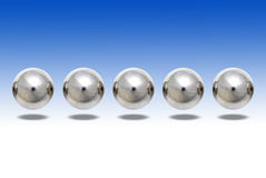 Ball Bearings Floating. Over background shot for a machinery manufacturer Royalty Free Stock Photo