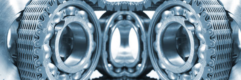 Ball bearings, gears and chains royalty free stock images