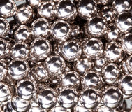 Ball bearings illuminated by white lights Royalty Free Stock Photos