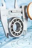 Ball bearings and Metal vernier caliper Stock Image