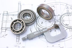 Ball bearings with micrometer on technical drawing.  royalty free stock photo