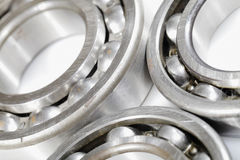 Ball bearings, pinions against whites Royalty Free Stock Photography