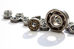 Ball Bearings Set. Industrial concept. Lot of ball bearings on white background stock images