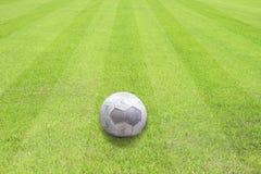 Ball on beautiful green grass of football sport. Soccer field Royalty Free Stock Photo