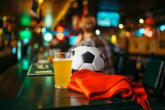 Ball, beer and scarf in sports bar, fans lifestyle royalty free stock photography
