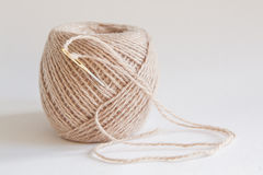 A ball of beige yarn Royalty Free Stock Image