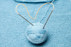Ball of blue wool with knitting needles Stock Photo